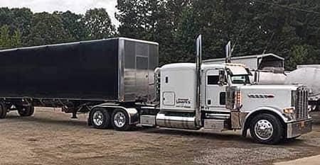 White truck with black conestoga
