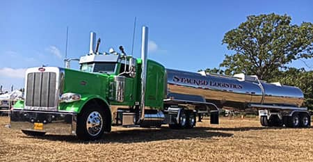 Green truck with silver tank